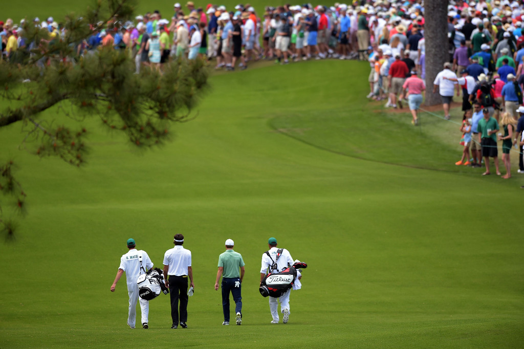 . Bubba Watson (L) and Jordan Spieth of the US walk down the fairway during the final round of the 78th Masters Golf Tournament at Augusta National Golf Club on April 13, 2014 in Augusta, Georgia.   JIM WATSON/AFP/Getty Images