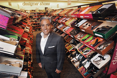 Geevy Thomas, president of Nordstrom Rack, is pictured in  the designer shoes section of the company's Seattle, Washington flagship store