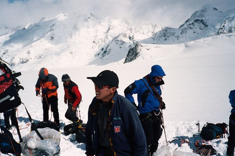 """""""Rope up for glacier travel! Check yourself, check your partner - then we'll check you"""" Bill Atkinson repeated this constantly in an attempt to speed everyone up - it didn't work :). Taken Just after landing. Clint (left), Erwin, Tshering (foreground), and Richard. 19 Feb 04"""