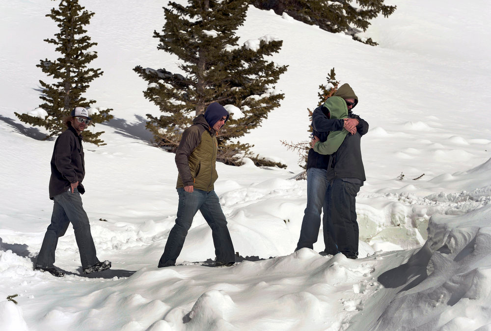 . Friends of 5 avalanche victims hug as they visit the site where their friends lost their lives on April 21, 2013.  The large hard slab avalanche happened in an area known as Sheep Creek near Loveland Pass  on the western flank of Mount Sniktau and happened around 2:00 pm on Saturday, April 20, 2013.  One of the victims was buried almost 13 feet deep.  (Photo By Helen H. Richardson/ The Denver Post)