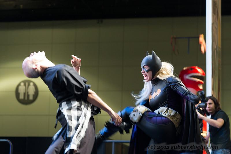 Batgirl (Marisha Ray) demonstrates a move on fight choreographer Paradox Pollack.
