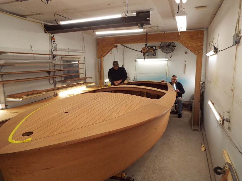 Another view of the final sanding being done on the hull.