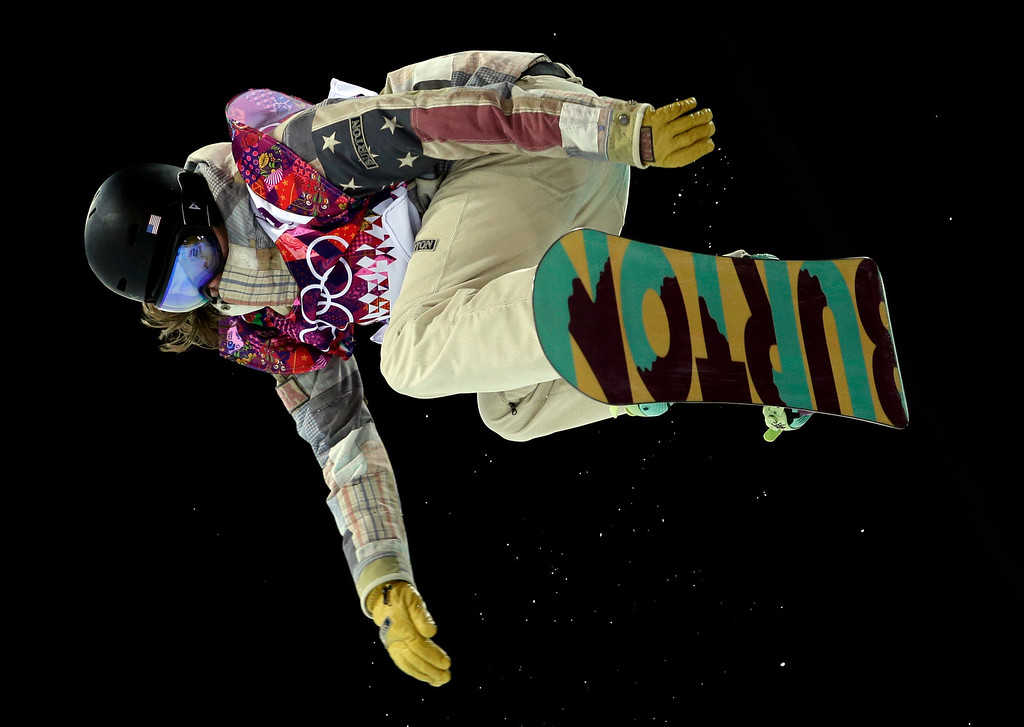 . United States\' Kelly Clark competes on her way to win the bronze in the women\'s snowboard halfpipe final at the Rosa Khutor Extreme Park, at the 2014 Winter Olympics, Wednesday, Feb. 12, 2014, in Krasnaya Polyana, Russia. (AP Photo/Felipe Dana)