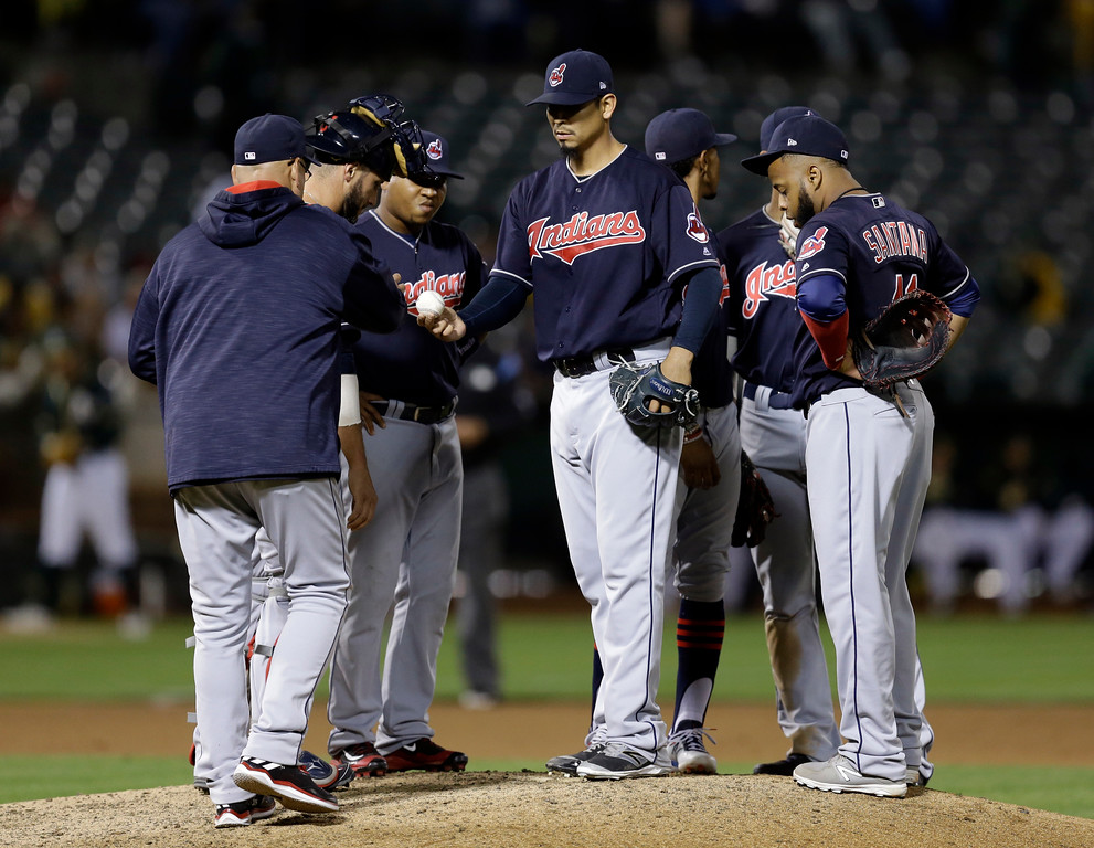 . Cleveland Indians pitcher Carlos Carrasco, center, hands the ball to manager Terry Francona as he is removed during the seventh inning of the team\'s baseball game against the Oakland Athletics on Friday, July 14, 2017, in Oakland, Calif. (AP Photo/Ben Margot)