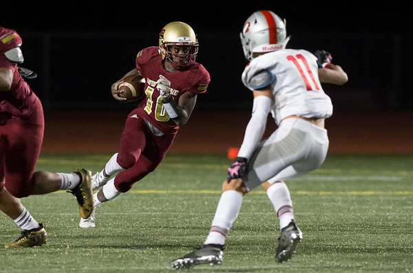 11/01/19 Wesley Bunnell | StaffrrNew Britain football was defeated 17-14 by Conard in OT in a game played on Friday night at Veterans Stadium. QB Tarik Hetmyer (10) with a keeper.