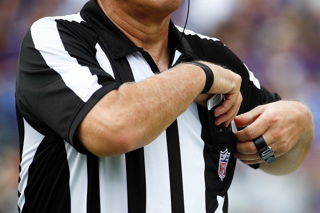 . A referee puts away his notes during the first half of an NFL football game between the Baltimore Ravens and the Cleveland Browns in Baltimore, Sunday, Sept. 17, 2017. (AP Photo/Patrick Semansky)