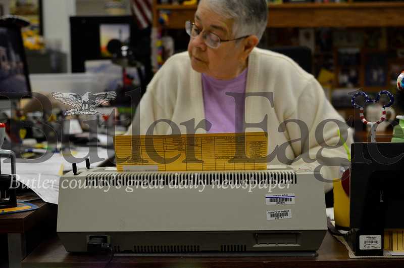 Michelle Montagna amends a property record using a typewriter in the Butler County Assessment office Friday. Montagna has worked as an assessment clerk for 25 years. She, like others in the office, still uses a typewriter everyday. Tanner Cole / Butler Eagle