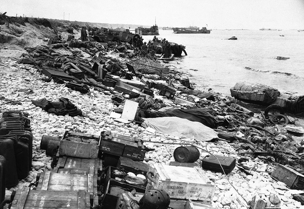 Description of . Wreckage and dead strewn along the beach, a grim reminder of the fury let loose on the Normandy beaches on D-Day in France, on June 20, 1944. (AP Photo)
