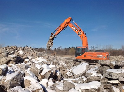 NPK M28G concrete pulverizer on Doosan excavator-concrete recycling.jpg