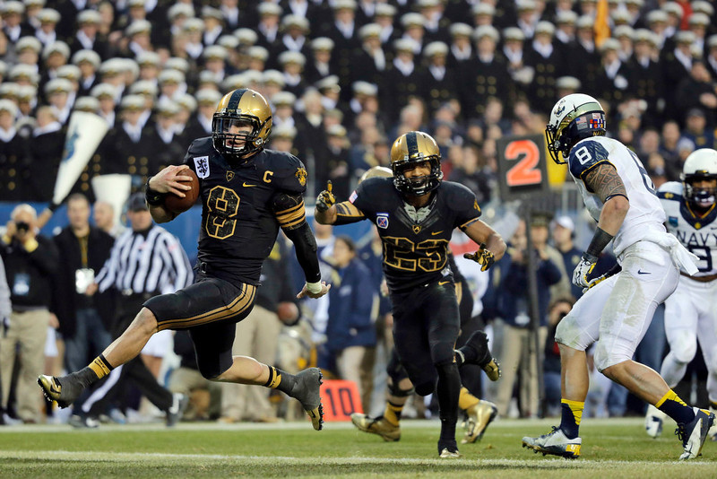 . Army\'s Trent Steelman, left, runs into the end zone for a touchdown past Navy\'s Wave Ryder, right, as Malcolm Brown, center, celebrates during the first half of an NCAA college football game, Saturday, Dec. 8, 2012, in Philadelphia. (AP Photo/Matt Slocum)