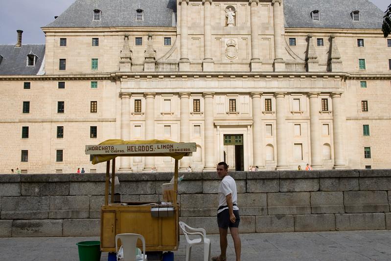 Street stall of ice creams in front of El Escorial facade, Spain