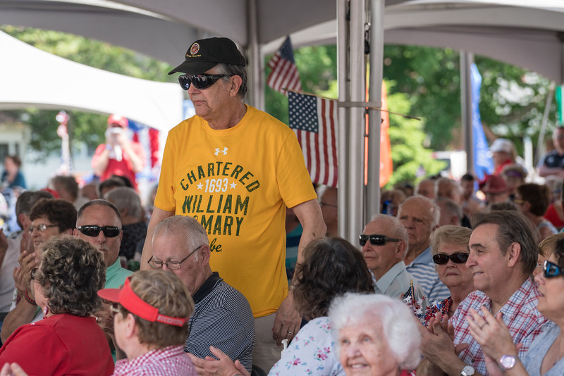Veteran standing for his Service song