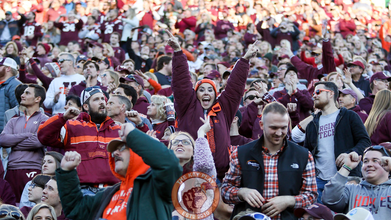 A fan in the East stands dances to a Hokievision promotion during a media timeout. (Mark Umansky/TheKeyPlay.com)