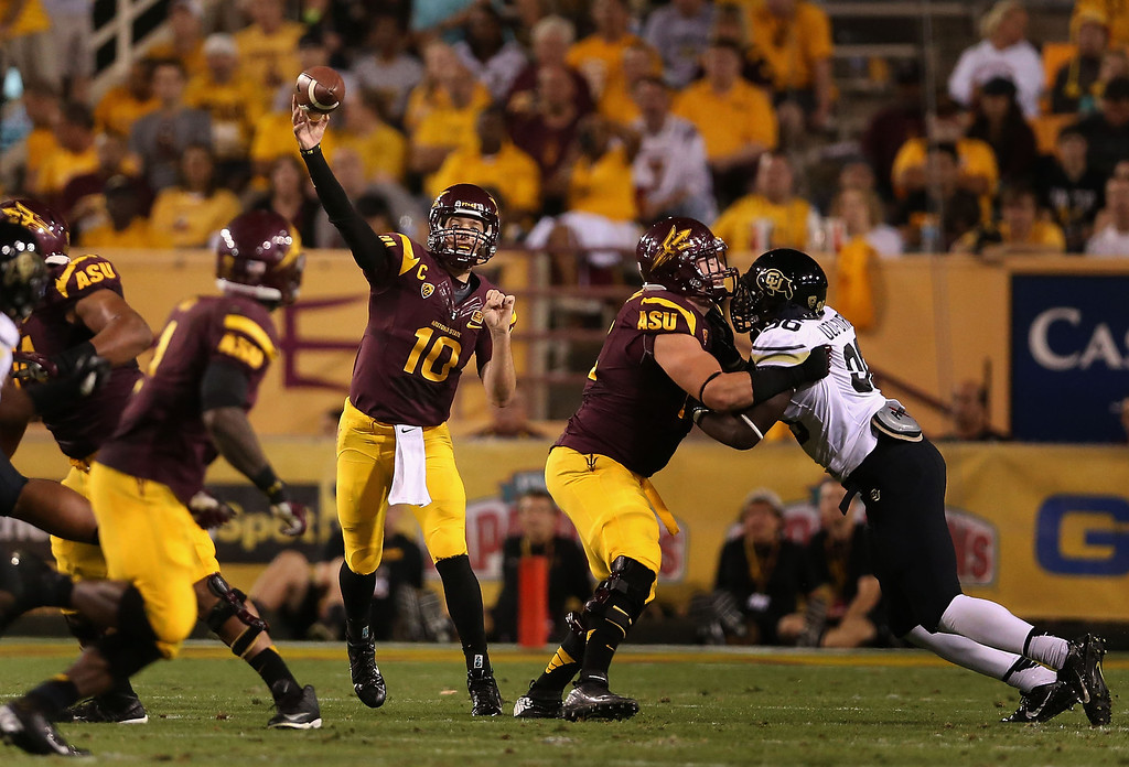 . TEMPE, AZ - OCTOBER 12:  Quarterback Taylor Kelly #10 of the Arizona State Sun Devils throws a pass during the second quarter of the college football game against the Colorado Buffaloes at Sun Devil Stadium on October 12, 2013 in Tempe, Arizona.  (Photo by Christian Petersen/Getty Images)