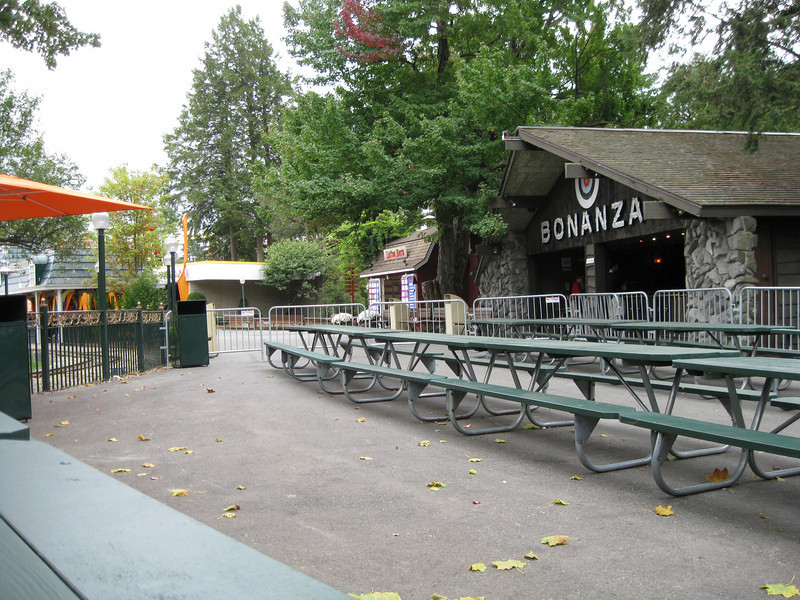 The outdoor seating area is fenced off from the rest of the park.