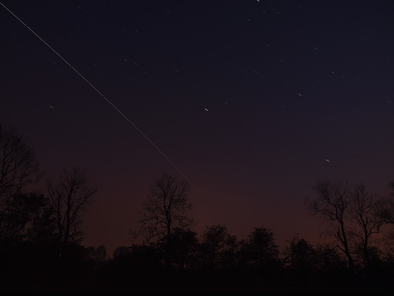 April 21 2011. International Space Station (ISS) passes over UK skies at 2125-2130 hrs. Set up 2 cameras looking south west and south east to maximise field of view, without distortion of a wide angle lens. This is the South West capture Oly E5. Both cams at ISO 400, E5 approx 12 No 6s exposures & E3 approx 12 No 10s exposures. Stacked in startrails software.