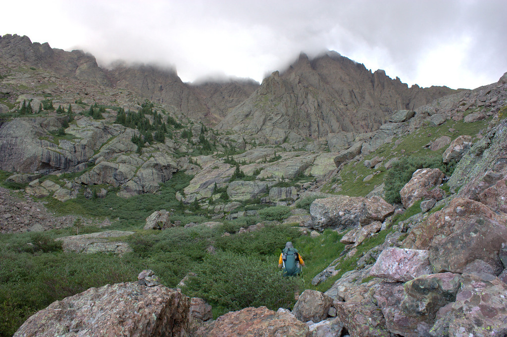 . Junaid Dawud approaches the Crestone Needle and Crestone Peak in late July, the sixth peak in his and pal Luke DeMuth\'s first-ever push to climb all the state\'s 58 fourteeners in a single hike. The pair have hiked 1,300 miles and climbed 57 of the state\'s 58 14,000-foot peaks and plan to finish their 70-day mission Sunday on Longs Peak.