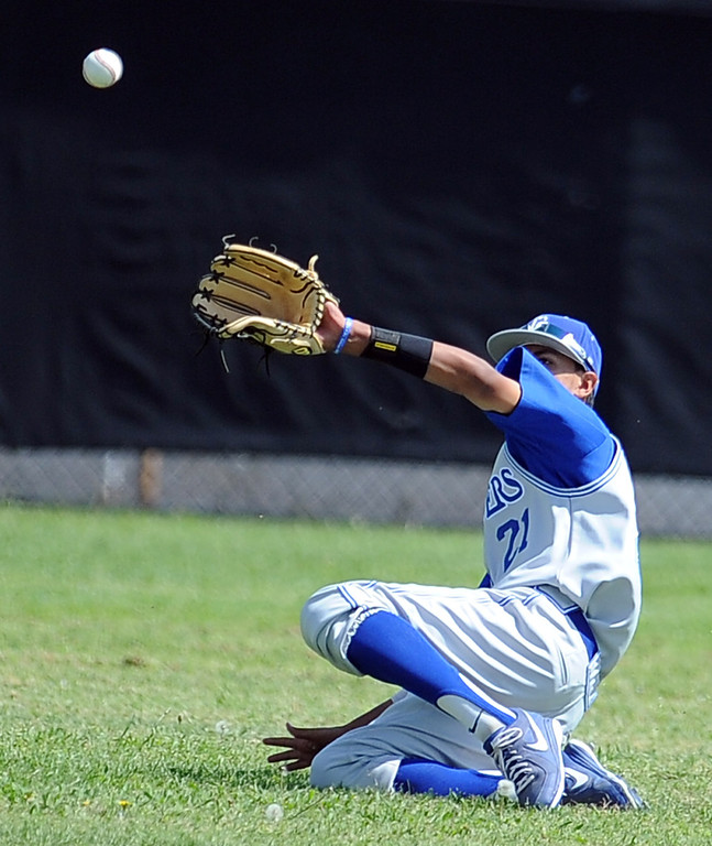. Charter Oak right fielder Elias Maldonado makes the catch on a drive by Duarte\'s Anthony Baroni (not pictured) in the third inning of the Championship game of the Gladstone Baseball Tournament at Gladstone High School on Wednesday, April 3, 2013 in Covina, Calif. Charter Oak won 5-3. (Keith Birmingham Pasadena Star-News)