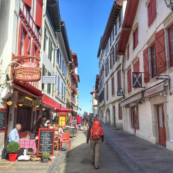 The streets of old town St. Jean de Luz, Basque France. At the local Marche les Halles, we met Monsieur Pétian, a vendor who had walked the Camino de Santiago 7 times and is now the man with the stamp, our first in our Peregrino passports. That and blue skies seemed an auspicious send-off as we headed south over the border to Spain. #lonelypilgrim via Instagram http://ift.tt/1NxMRor