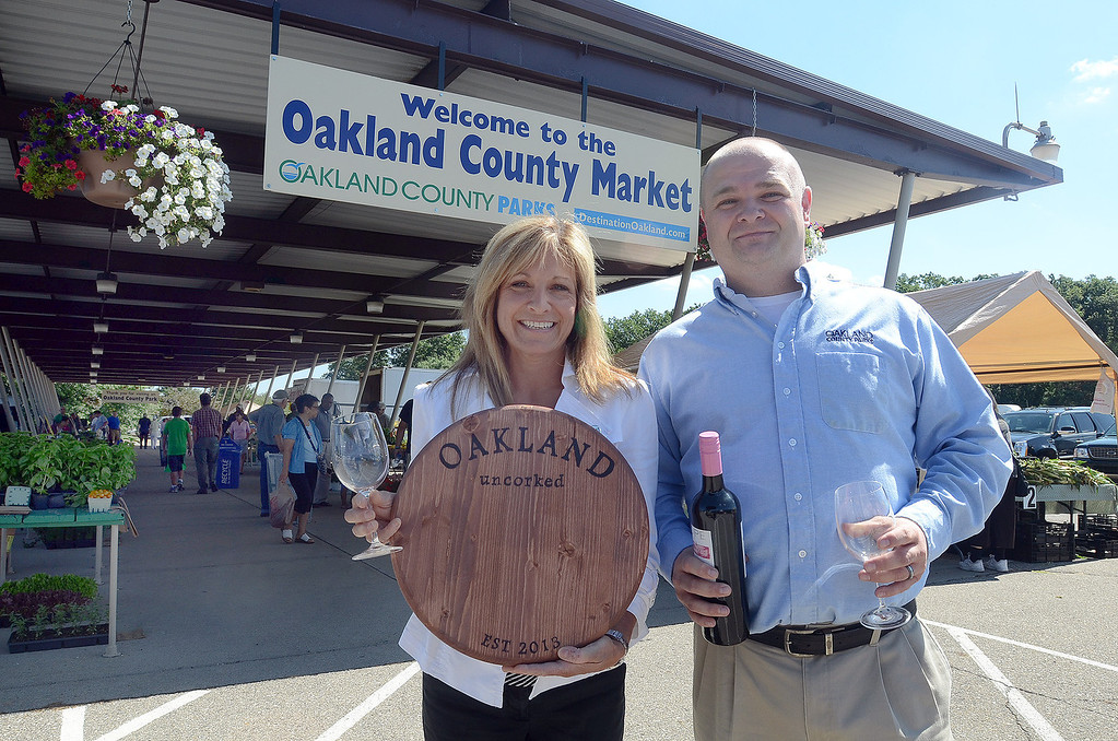 . Marie Hauswirth, (left) Executive Director of the Waterford Area Chamber of Commerce and Jeremy Brown, Oakland County Farmers Market manager, will take part in the Oakland Uncorked wine & food tasting experience August 2nd, pictured Thursday July 25, 2013. (Oakland Press Photo:Vaughn Gurganian)