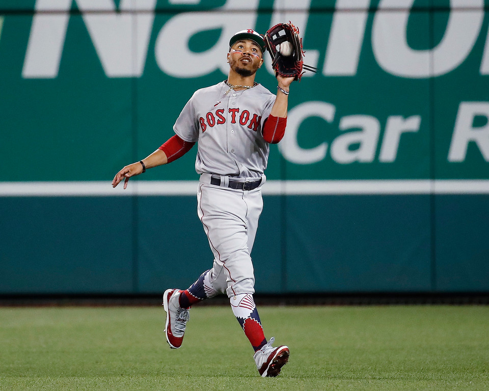. Boston Red Sox outfielder Mookie Betts (50) catches a fly ball hit by Chicago Cubs Javier Baez in the fifth inning of the Major League Baseball All-star Game, Tuesday, July 17, 2018 in Washington. (AP Photo/Alex Brandon)