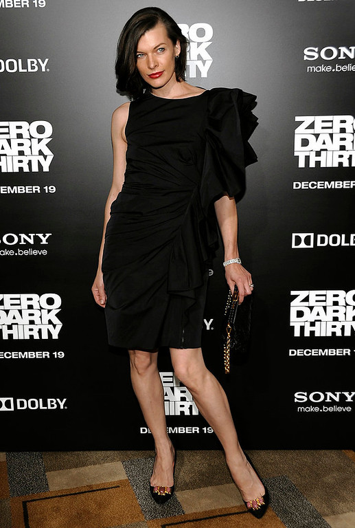 """. Actress Milla Jovovich arrives at the premiere of the feature film \""""Zero Dark Thirty\"""" at the Dolby Theatre in Los Angeles on Monday, Dec. 10, 2012. (Photo by Dan Steinberg/Invision/AP)"""