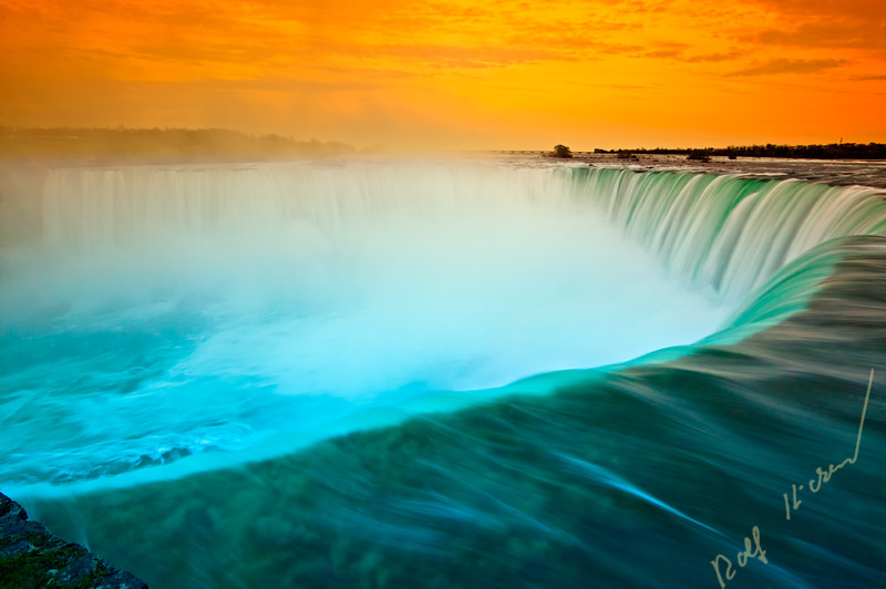 Famous Niagara Falls (Horseshoe Waterfall) in spring at sunset, Ontario, Canada.