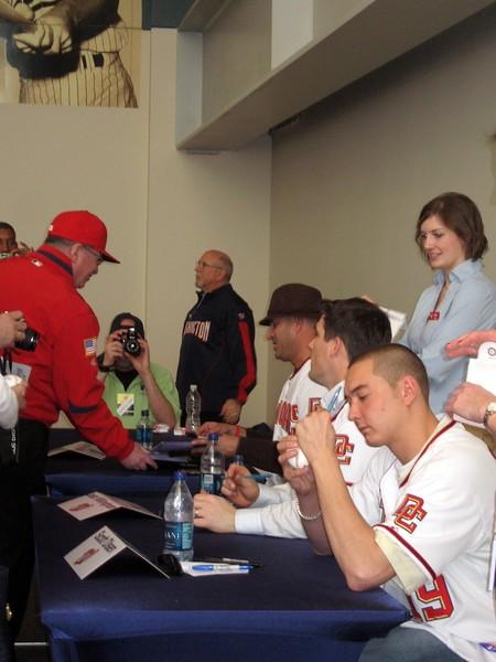 Nationals manager Manny Acta, left fielder Josh Willingham, and pitcher Scott Olsen sign autographs