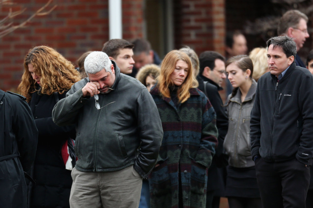 Description of . People arrive for the funeral services of six year-old Noah Pozner, who was  killed in the shooting massacre in Newtown, CT, at Abraham L. Green and Son Funeral Home on December 17, 2012 in Fairfield, Connecticut. Today is the first day of funerals for some of the twenty children and seven adults who were killed by 20-year-old Adam Lanza on December 14, 2012.  (Photo by Spencer Platt/Getty Images)