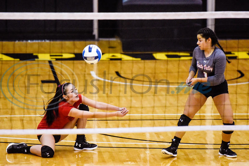 Trinity Valley Community College Livia Kumura (2) dives for the ball as teammate Audry Lopez (1) watches during a college volleyball game at Tyler Junior College in Tyler, Texas, on Wednesday, Sept. 19, 2018. (Chelsea Purgahn/Tyler Morning Telegraph)