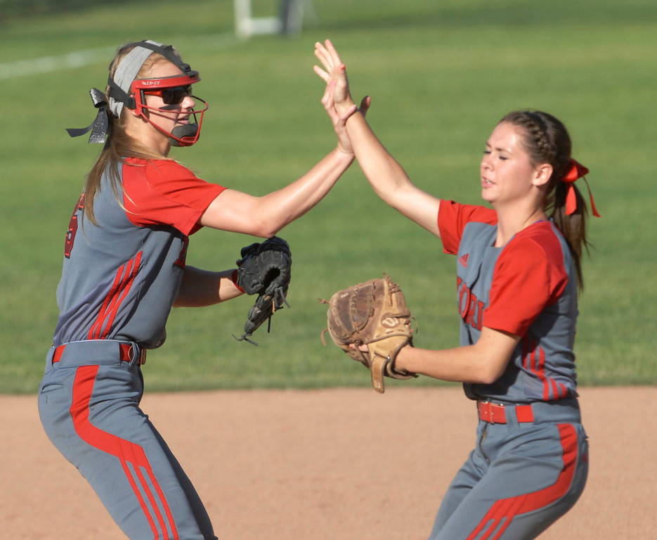 . Jeff Forman/JForman@News-Herald.com Elyria short stop and second baseman Carly Bachna and Mackenzie Phares celebrate a double play during the Pioneer\'s 9-1 state semi final loss June 5 at Firestone Stadium in Akron.