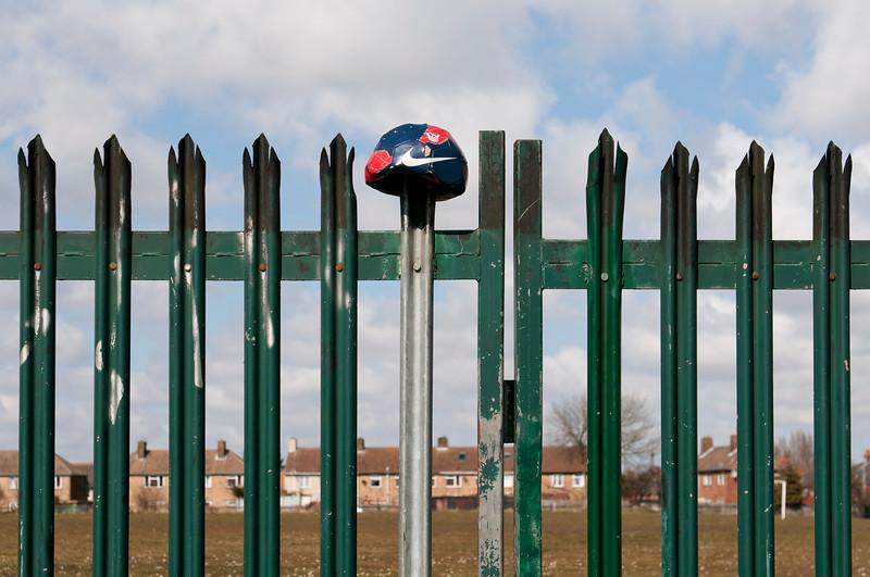 Football on fence