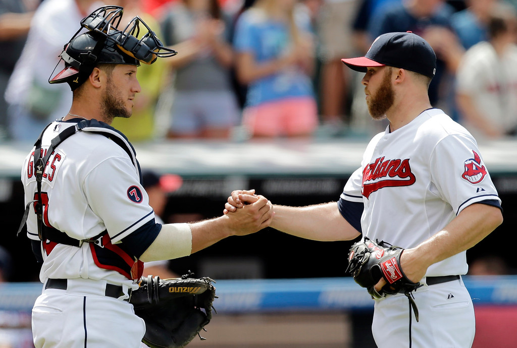 . Cleveland Indians catcher Yan Gomes, left, congratulates relief pitcher Cody Allen after the Indians defeated the Detroit Tigers 8-2 in a baseball game, Wednesday, June 24, 2015, in Cleveland. (AP Photo/Tony Dejak)