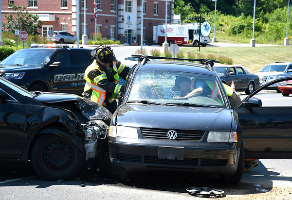 7/10/2018 Mike Orazzi | Staff Bristol fire fighters on scene of a two-car crash on Middle Street near the intersection of Pine and Middle Streets Tuesday. Minor injuries were reported.