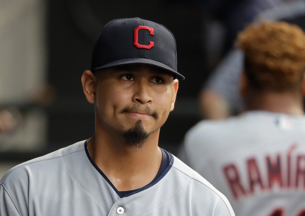 . Cleveland Indians starting pitcher Carlos Carrasco walks through the dugout during the second inning of a baseball game against the Chicago White Sox Monday, June 11, 2018, in Chicago. (AP Photo/Charles Rex Arbogast)
