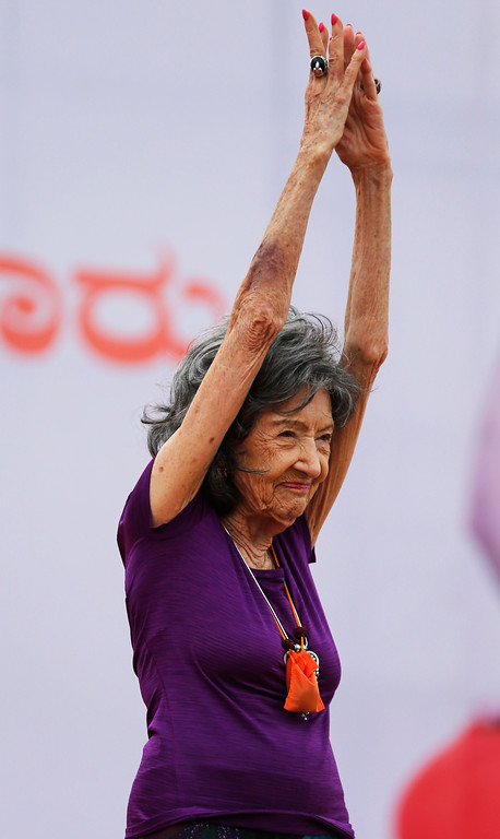 . Yoga instructor, Tao Porchon-Lynch, 98, performs at a function to mark International Yoga Day in Bangalore, India, Wednesday, June 21, 2017. Yoga practitioners took a relaxing break to bend, twist and pose Wednesday morning for the annual event celebrating the practice, especially in the country where it began. (AP Photo/Aijaz Rahi)