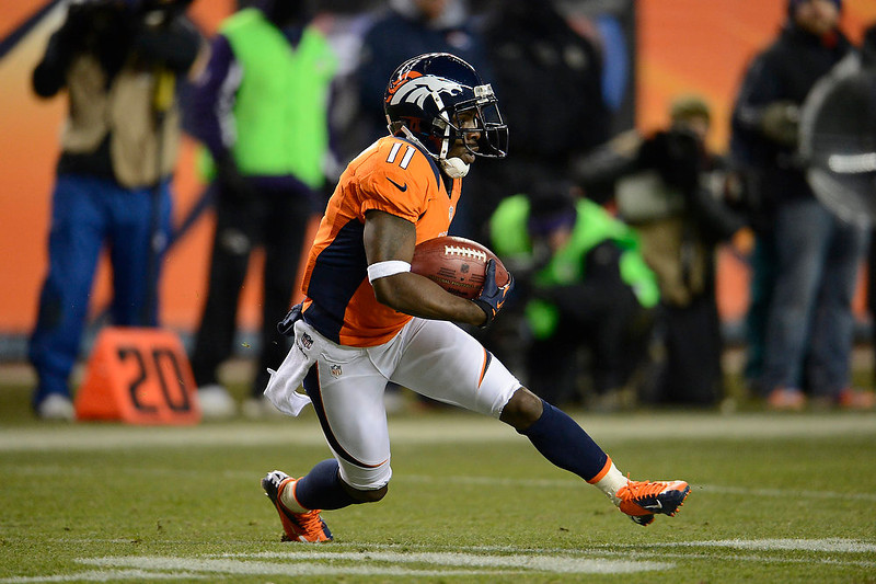 . Denver Broncos wide receiver Trindon Holliday (11) runs the ball during the fourth quarter.  The Denver Broncos vs Baltimore Ravens AFC Divisional playoff game at Sports Authority Field Saturday January 12, 2013. (Photo by John Leyba,/The Denver Post)