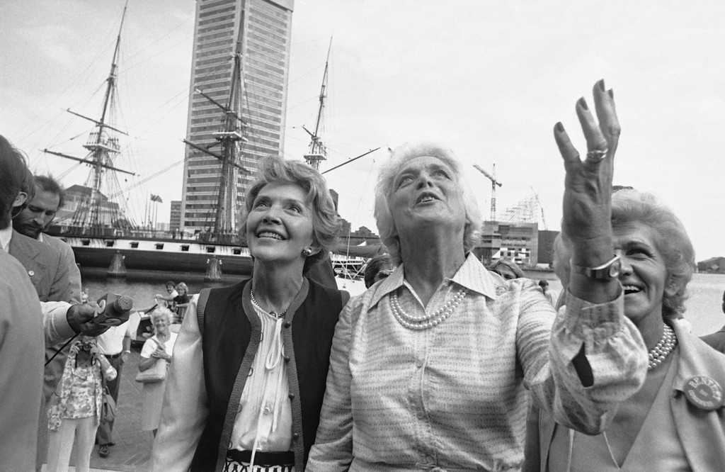 . Nancy Reagan, left and Barbara Bush, right, wives of the GOP nominees for President and Vice President, plead to a crowd lining a balcony for their votes in this November�s general election on Sept. 15, 1980 in Baltimore, Md.     The wives toured the Baltimore Inner Harbor while campaigning for their husbands. (AP Photo/William Smith)