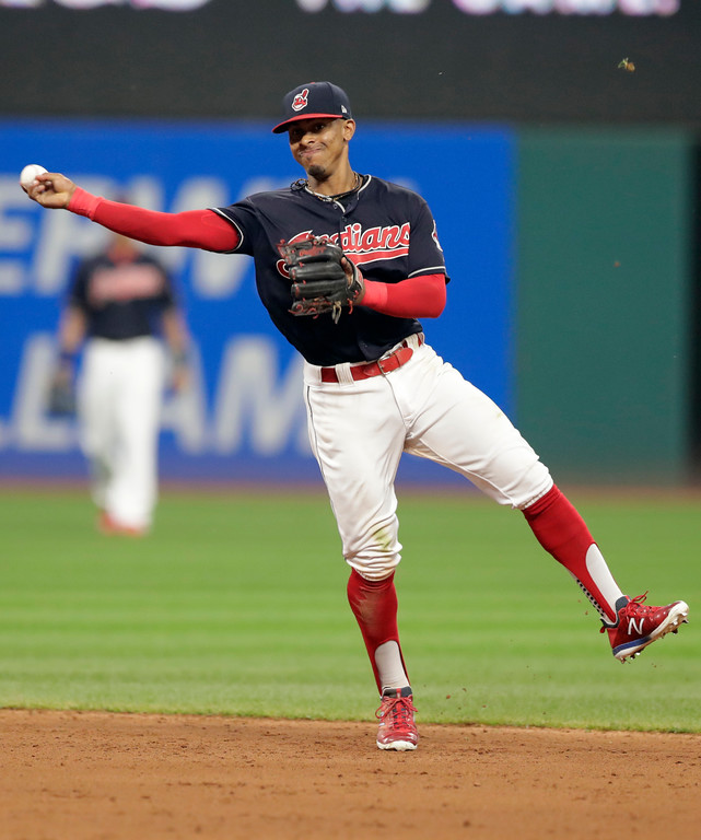 . Cleveland Indians\' Francisco Lindor throws out Pittsburgh Pirates\' Josh Harrison in the fifth inning of a baseball game, Tuesday, July 24, 2018, in Cleveland. (AP Photo/Tony Dejak)