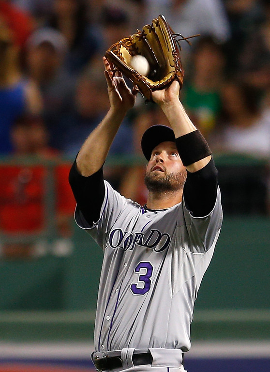 . Michael Cuddyer #3 of the Colorado Rockies catches a fly ball from the bat of Dustin Pedroia #15 of the Boston Red Sox in the 5th inning at Fenway Park on June 25, 2013 in Boston, Massachusetts.  (Photo by Jim Rogash/Getty Images)