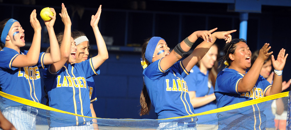 . Bishop Amat bench reacts to Alexis Gonzalez (not pictured) double in the sixth inning of a prep softball game against Santiago at Bishop Amat High School on Wednesday, March 27, 2013 in La Puente, Calif. Bishop Amat won 5-3.  (Keith Birmingham Pasadena Star-News)