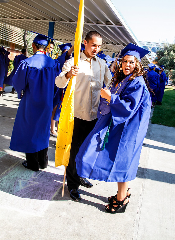 . Associated Student Body President, Khrista Abasi takes a minute to talk with Javier Valdez, Honor Guard and future 2014 graduate at, John H Francis Polytechnic High School, Sun Valley, Calif., June 7, 2013. Photo: Lynn Levitt.
