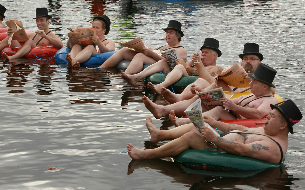 . Men dressed as \'greedy businessmen\' float in the Serpentine Lake in Hyde Park for a mobile phone promotion on June 16, 2010 in London, England. Giffgaff promotes  it\'s new mobile phone tarrif as \'community-led\'.  (Photo by Peter Macdiarmid/Getty Images)