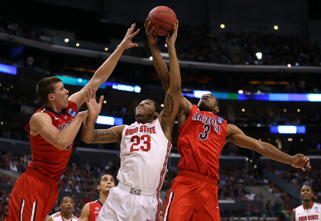 . Amir Williams #23 of the Ohio State Buckeyes goes for the ball between Kaleb Tarczewski #35 and Kevin Parrom #3 of the Arizona Wildcats in the first half during the West Regional of the 2013 NCAA Men\'s Basketball Tournament at Staples Center on March 28, 2013 in Los Angeles, California.  (Photo by Jeff Gross/Getty Images)