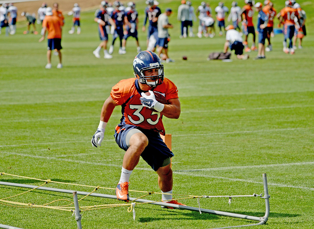 . Jerodis Williams runs drills during practices at Dove Valley in Centennial, August 21, 2014. The Denver Broncos take on the Houston Texans, in Denver on Saturday, in their third pre-season game. (Photo by RJ Sangosti/The Denver Post)