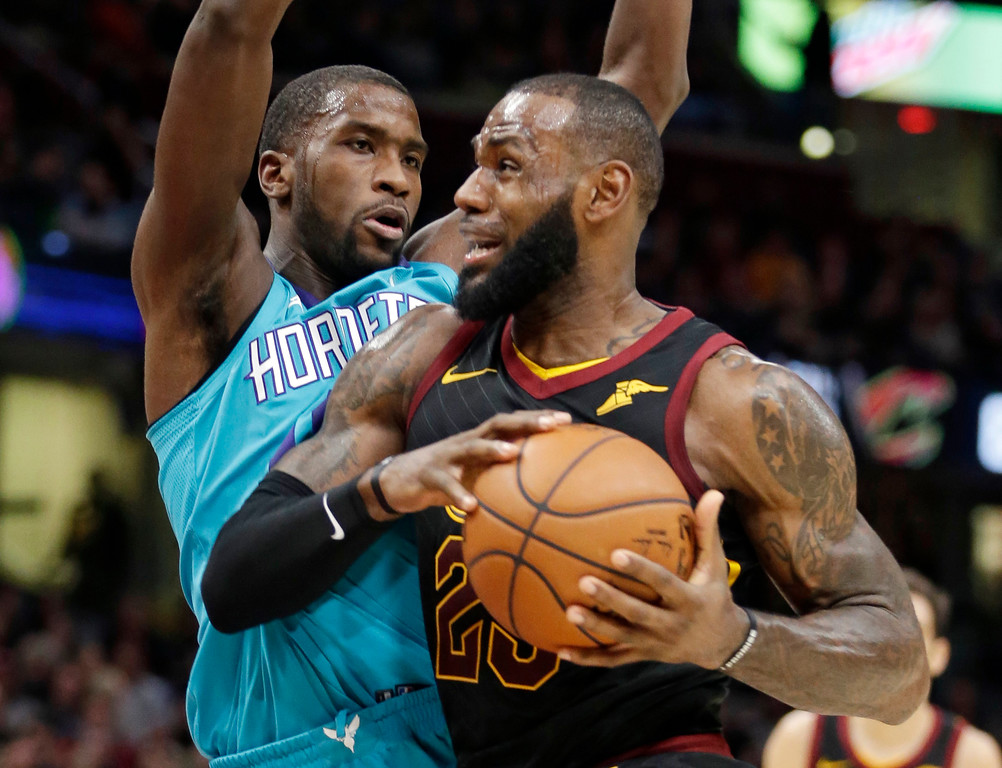 . Cleveland Cavaliers\' LeBron James, right, drives past Charlotte Hornets\' Michael Kidd-Gilchrist in the first half of an NBA basketball game, Friday, Nov. 24, 2017, in Cleveland. (AP Photo/Tony Dejak)