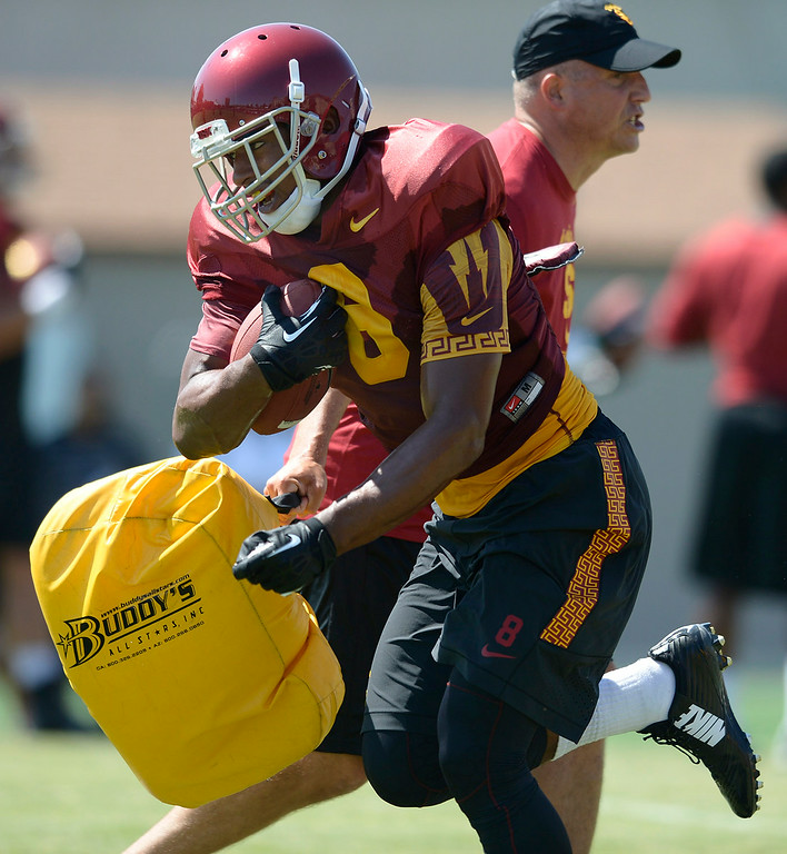 . George Farmer runs through a bag held by coach Clay Helton. Football practice is in full swing on the Howard Jones Field at USC. Los Angeles, CA. 8/6/2014(Photo by John McCoy Daily News)