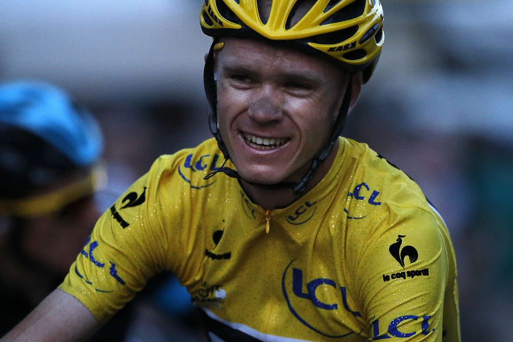 . Tour de France 2013 winner Britain\'s Christopher Froome smiles on the Champs-Elysee avenue in Paris, after crossing the finish line of the 133.5 km twenty-first and last stage of the 100th edition of the Tour de France cycling race on July 21, 2013 between Versailles and Paris.  JEFF PACHOUD/AFP/Getty Images