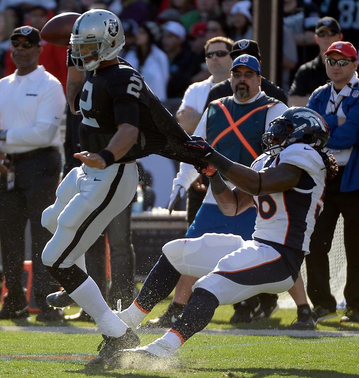 . Denver Broncos outside linebacker Nate Irving (56) hauls down Oakland Raiders quarterback Terrelle Pryor (2) for a sack in the first quarter at O.co Coliseum. (Photo by John Leyba/The Denver Post)