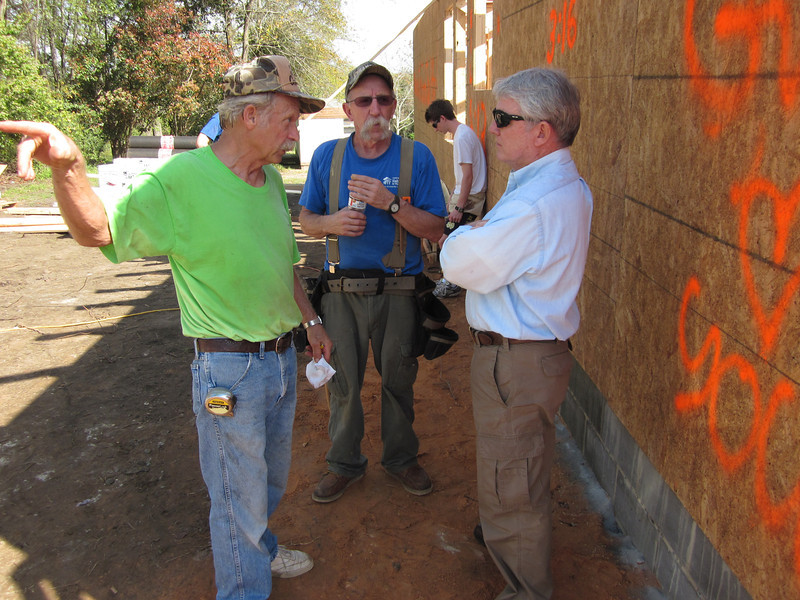 Three of the six men who visited North Korea with The Fuller Center for Housing in December 2011 reunite at the site of the Southwest Quarter Fuller Center's build in Lumpkin, Ga., on March 14, 2012. From left are Charlie Thell, Tim DuBois and Frank Purvis.